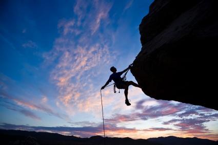 Rock climber rappelling.